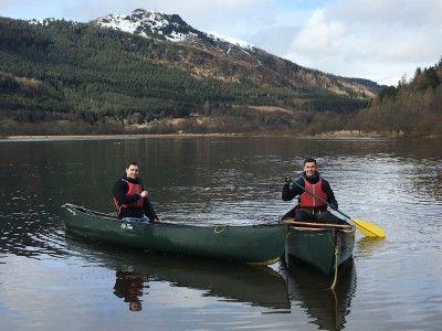 two-young-people-canoeing-on-the-loch