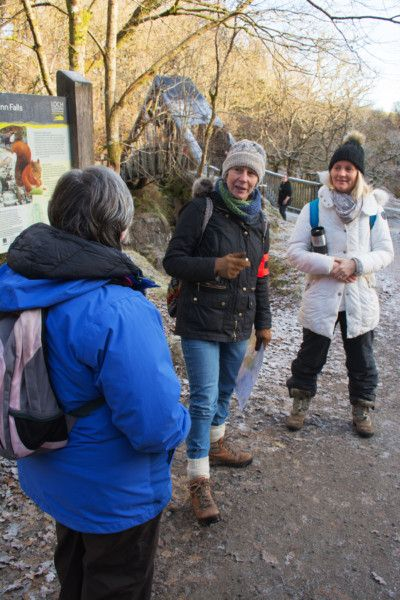 Mairi, one of our volunteer Gaelic guides, leading a walk to Bracklinn Falls (December 2019) [Photo by Keith Ratcliffe]