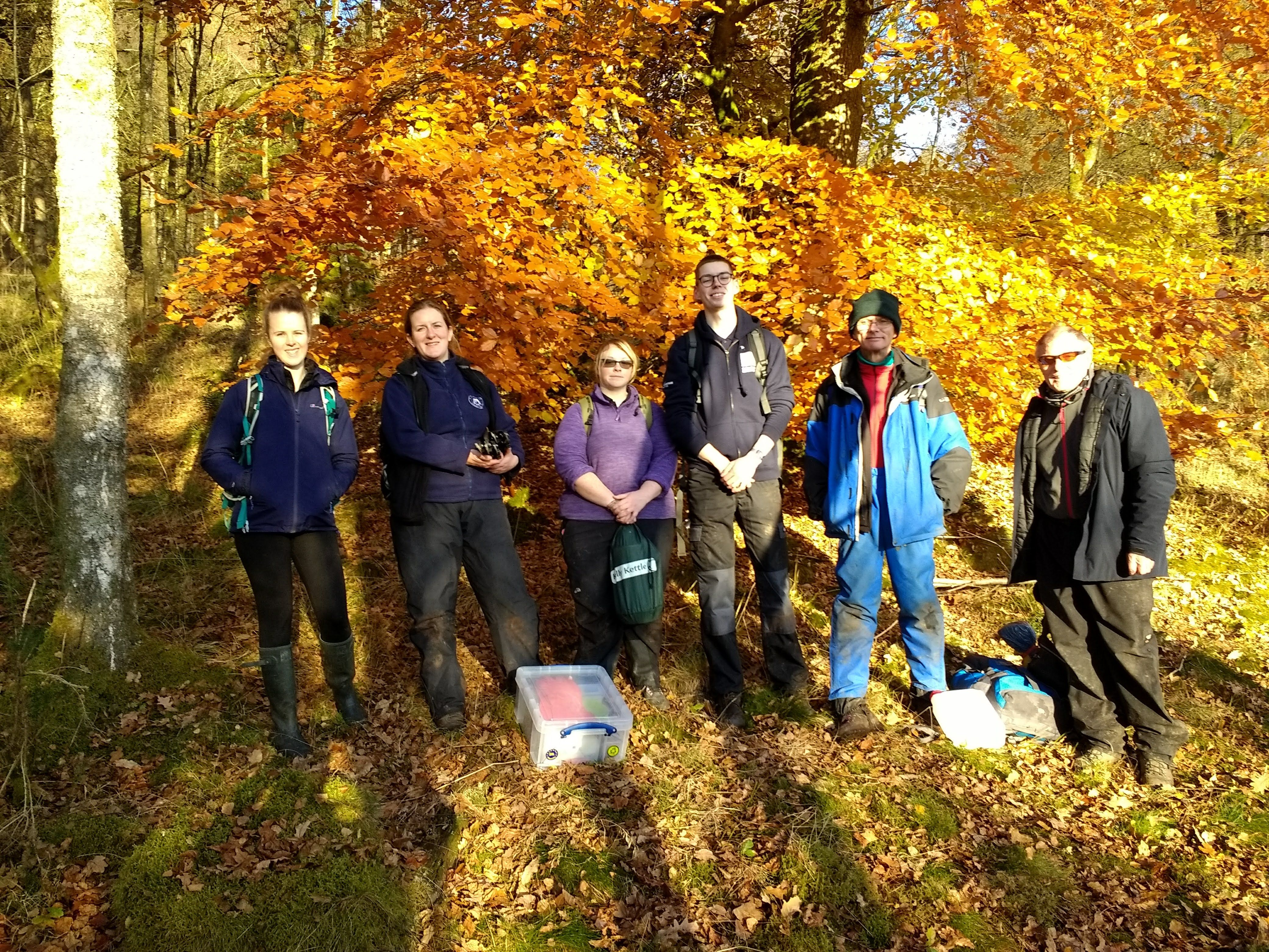 six-people-smiling-in-the-winter-sun-after-volunteering