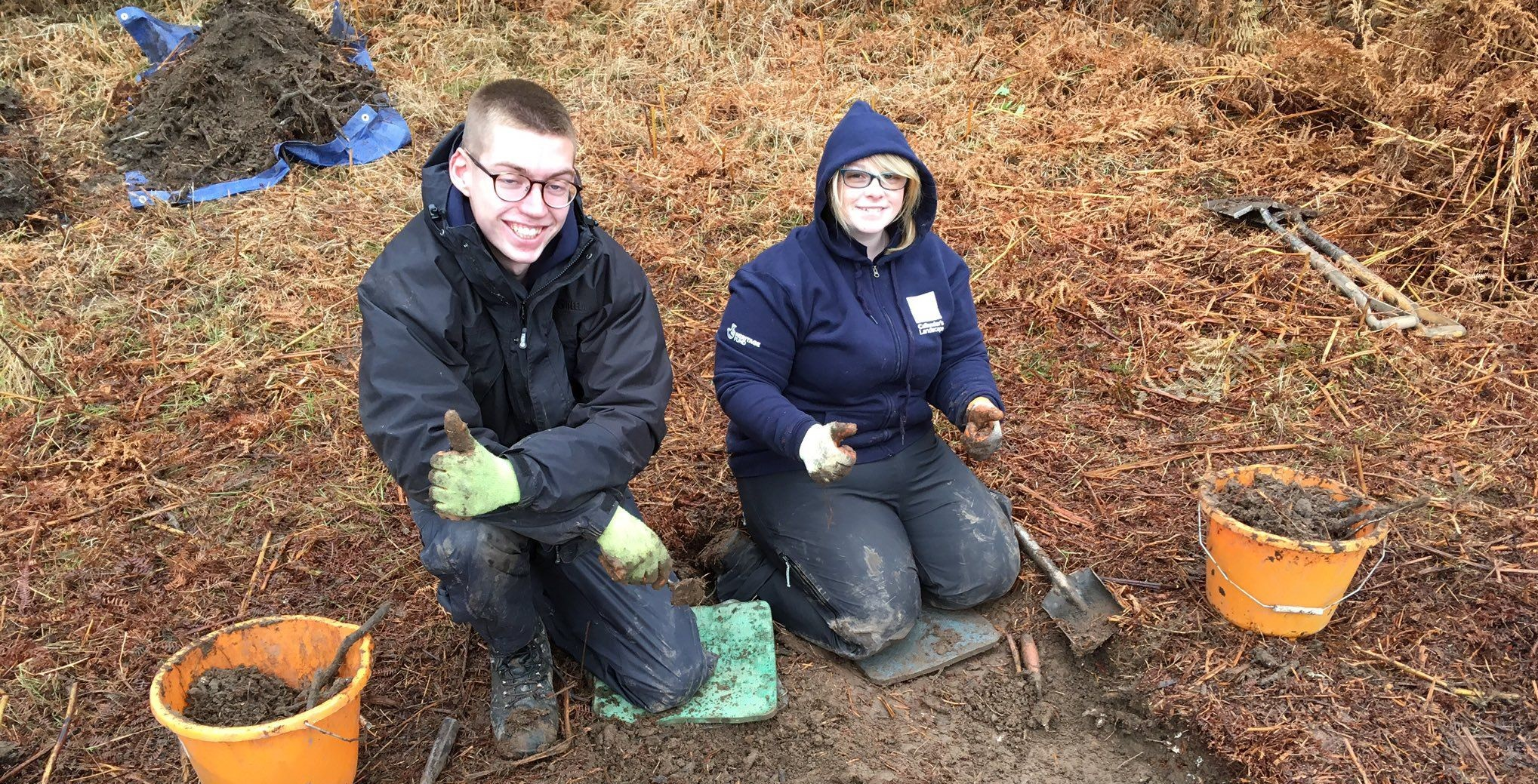 two-young-people-taking-part-in-an-archaeological-excavation