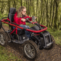 woman-using-mobility-scooter-in-a-woodland