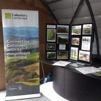 event-display-with-pop-up-banner-display-board-and-leaflets-on-a-table