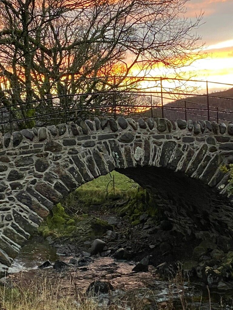 The-completed-bridge-after-restoration-at-sunset.
