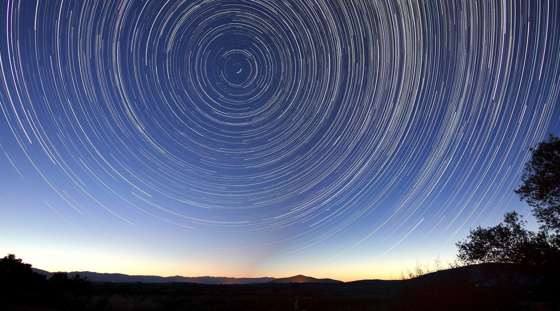 photo of star trails in the night sky